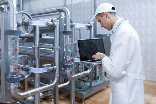 Technologist-with-a-laptop-at-dairy-plant