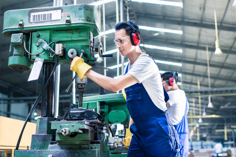 worker-in-production-plant-drilling-at-machine-on-the-factory-floor